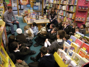 Kieran reads with the boys and girls from Dominican Convent Primary School
